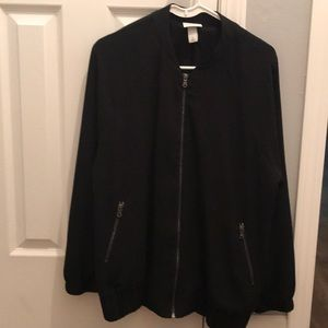 Woman's black bomber type zip up.